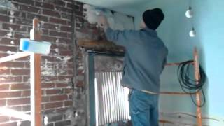 How to plaster a brick wall.