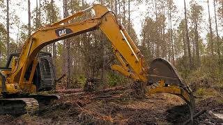 LAND CLEARING WITH A 315C CAT EXCAVATOR