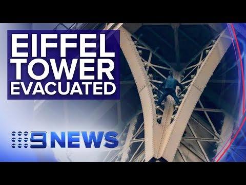 Paris tower locked down as man climbs monument | Nine News Australia