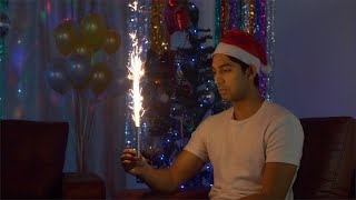 Unhappy Indian guy is disappointed when no one comes to his house party - Christmas Eve India