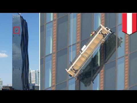 Dangerous jobs: Window cleaners left hanging 48 floors up at Donau City Tower 1 in Vienna, Austria