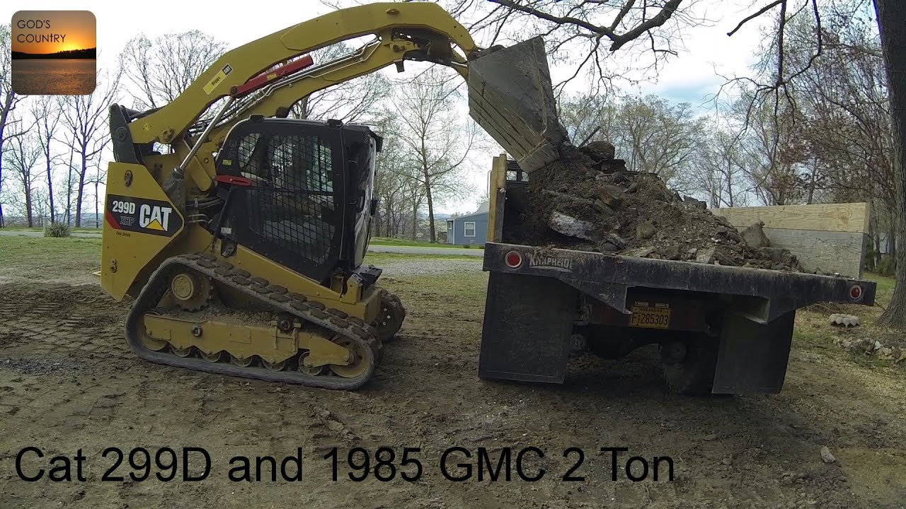 Cat 299d xhp loading and a 1985 gmc 2 ton dumping youtube publicscrutiny Image collections
