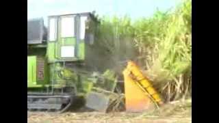 Repeat youtube video รถตัดอ้อย  SMKY Sugarcane Harvester, NEWS (Ambassador of Brazil visit SMKY)