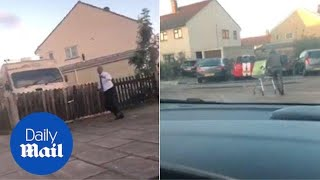 Security guard chases man pushing shopping trolley full of TVs