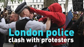 Watch London protesters clash with police