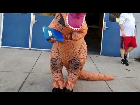 Northumberland Christian School Teacher delivers homework as a dinosaur