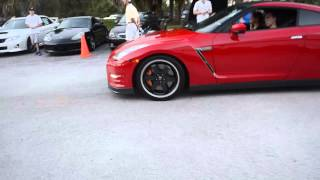 Nissan GtR pulling into cars and coffee