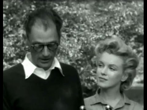 Footage of Marilyn Monroe and Arthur miller press conference before trip to England 1956