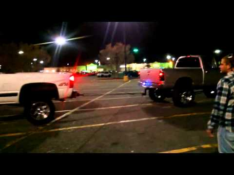 Cummins drags Chevy around shopping mall parking