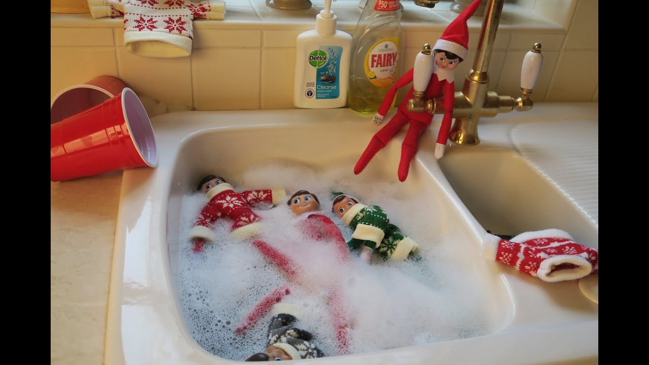 Naughty Elf Dives Into Swimming Pool Youtube