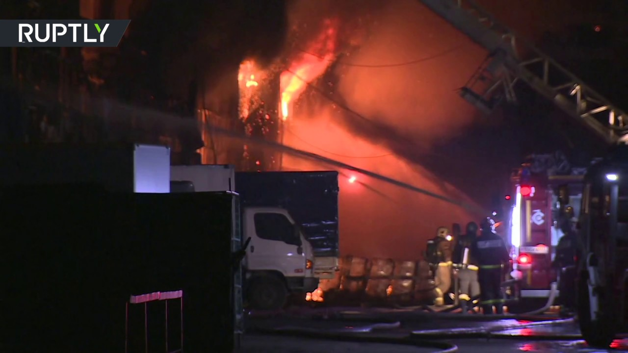 Helicopters, firefighters battle massive blaze at Moscow warehouse