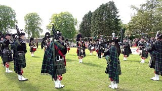 Lonach Pipe Band display during Oldmeldrum Highland Games in Aberdeenshire Scotland June 2019