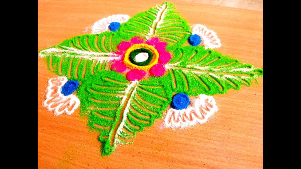 colourful art of rangoli with flowers and leaves by