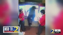 WATCH: Chick-fil-A worker jumps through drive-thru window, saves choking boy