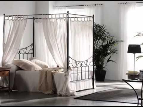 camas con cabeceros y pieceros de forja y con dosel