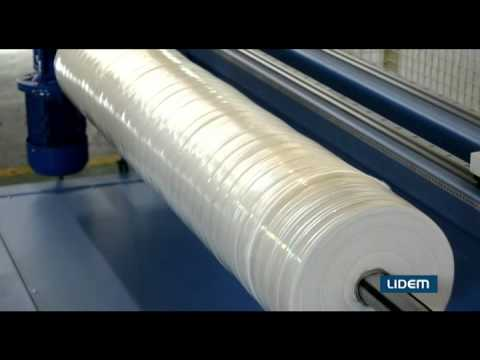 Roll cutter or slitter with pneumatic shaft and automatic positioning for nonwoven, fabric, plastics