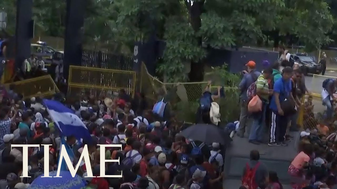 Migrants Break Through Fence At Guatemala Border | TIME
