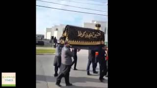 Ahmadiyya Muslims serving drinks to a Shia procession in Calgary, Canada