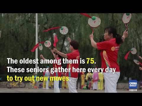 Seniors practice Soft-strength Ball exercises at Beijing Sport University