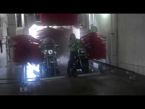 Motorcycles in a car wash - with brushes