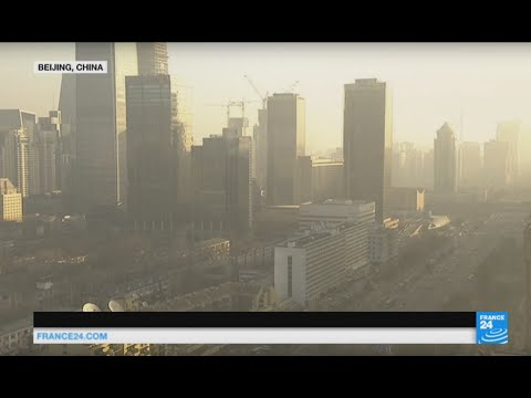 China: natural sunlight breaks through over Beijing's skyline as red alert is lifted