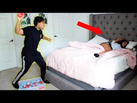 THROWING WATER BALLOONS AT SLEEPING GIRLFRIEND PRANK!!