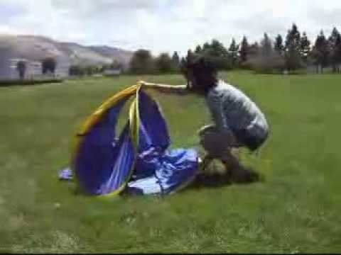 & How to fold a pop-up beach tent - YouTube