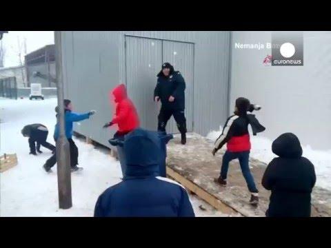 Migrant children attack Serbia border police...with snowballs!