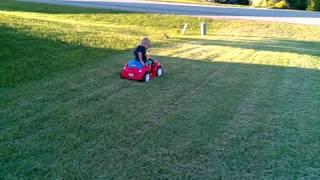 Coy riding his little Red Car, 6 volt to 18 volt