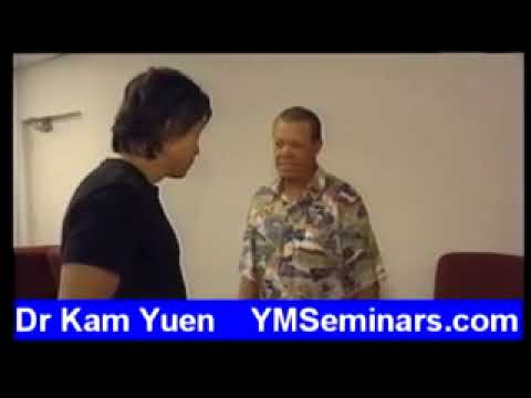 Dr Kam Yuen in the LA Dodgers Clubhouse with Maury Wills