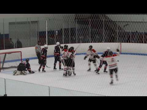 Jon Tavella scores for Pope Francis High School hockey against Central Catholic