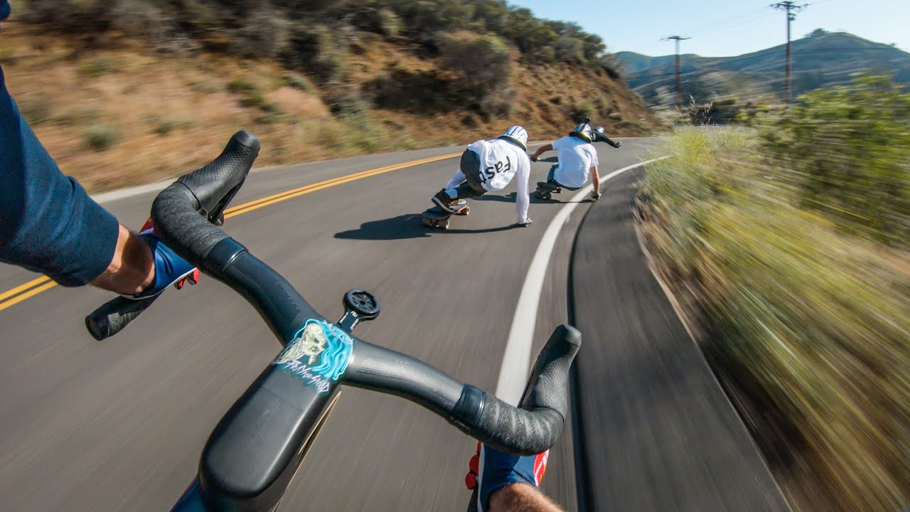 Longboarders vs Cyclist - Who's Faster?