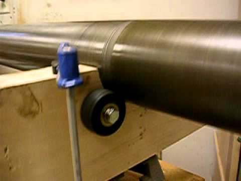 Polishing a drill press column on a wood lathe