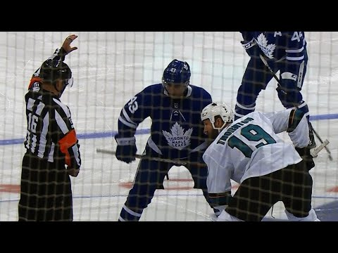 Two seconds into the game Nazem Kadri, Joe Thornton drop the gloves