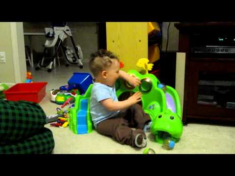 Ethan Playing With Roll-a-Rounds Drop & Roar Dinosaur