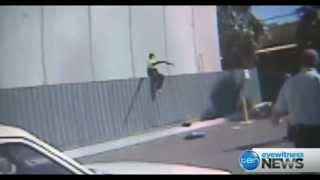 """CCTV of Christopher """"Badness"""" Binse robbing guards at gunpoint"""
