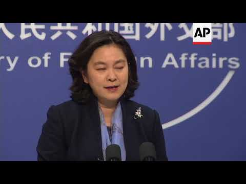 China on Germany's call to release lawyer and US spying claims
