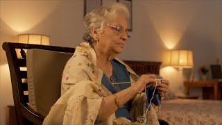 Shot of old Indian grandmother knitting woolen clothes