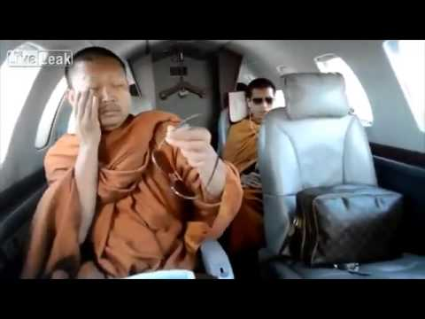 Buddhist monks travel on private jet