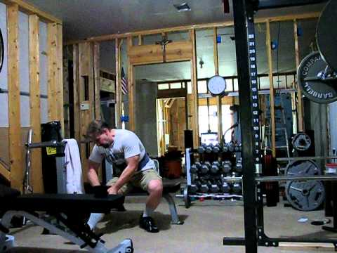 old lifter putting on the knee wraps in basement gym  youtube