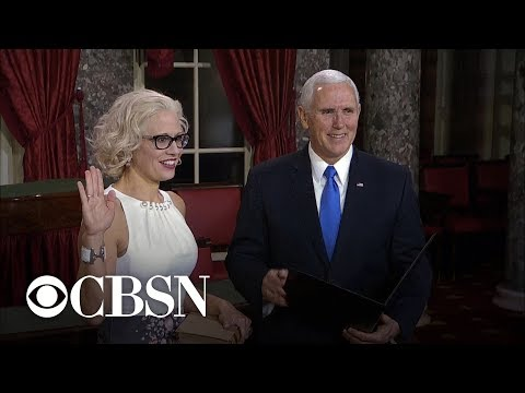 Kyrsten Sinema takes oath as senator on copy of constitution