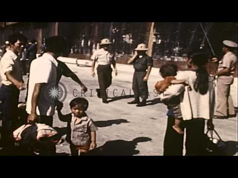 Vietnamese refugees arrive in Guam aboard the SS Transcolorado, during Operation ...HD Stock Footage