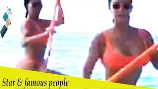 Kim Kardashian shows off her tiny waist paddleboarding in a bikini
