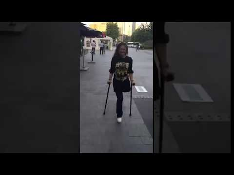 Amputee woman vs escalator