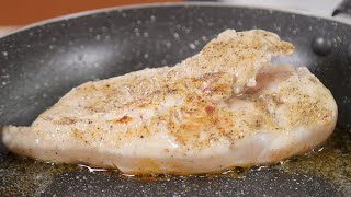 Close up shot of raw chicken breast being fried in oil