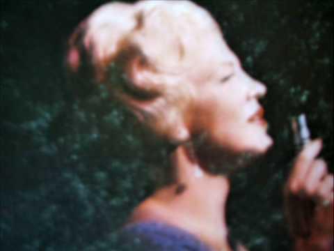Peggy Lee sings