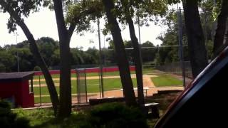 At a baseball field relaxing before the game