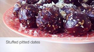 Stuffd pitted dates with walnut. Simple recipe for a healthy snacks