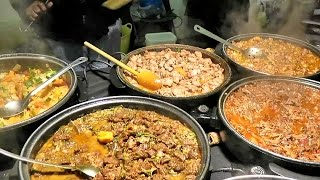 London Street Food. Preparing Caribbean Food from Jamaica. Seen in Brick Lane