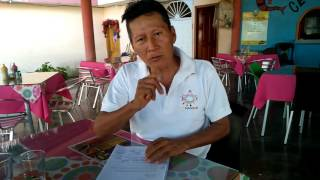 Jose Quenama, one of the top indigenous leaders of Ecuador, signing the Nature Nations Declaration